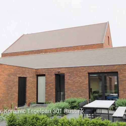 Villa en bijgebouw in karaktervolle materialen